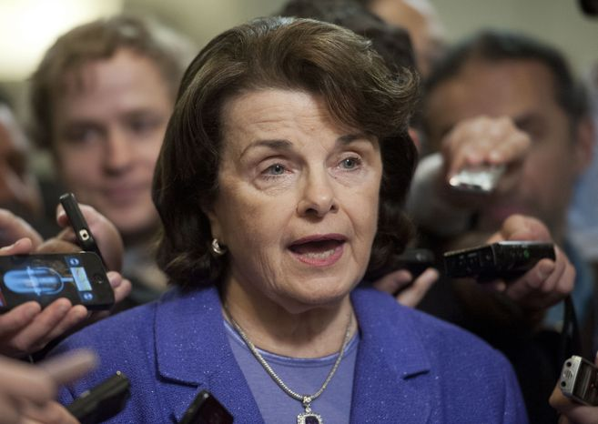 Senate Intelligence Committee Chair Sen. Dianne Feinstein, California Democrat, is surrounded by reporters on Capitol Hill in Washington on Nov. 16, 2012, following a closed-door hearing of the committee where former CIA Director David Petraeus testified. (Associated Press)