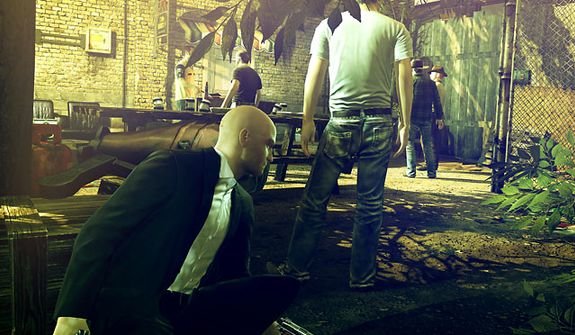 Agent 47 crouches and hides often in the video game Hitman: Absolution.