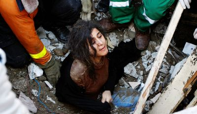 A member of the Abdel Aal family is rescued after his family house collapsed during an Israeli forces strike in the Tufah neighbourhood, Gaza City. (AP Photo/Majed Hamdan)