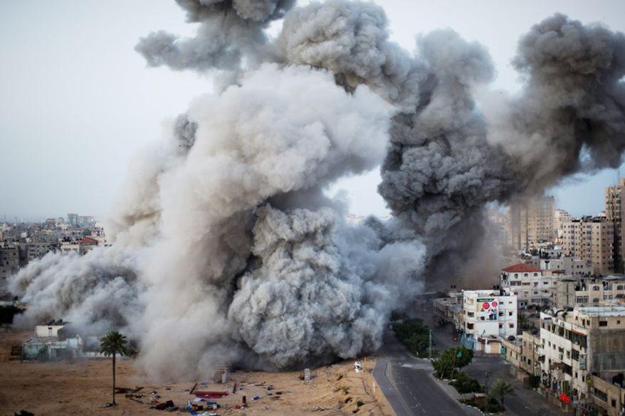 Smoke rises after an Israeli forces strike in Gaza City, Sunday, Nov. 18, 2012. (AP Photo/Bernat Armangue)
