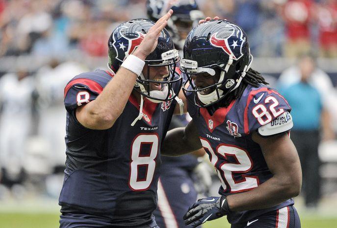 Houston Texans quarterback Matt Schaub (8) and Keshawn Martin (82) celebrates a touchdown during the first quarter of an NFL football game against the Jacksonville Jaguars Sunday, Nov. 18, 2012, in Houston. (AP Photo/Dave Einsel)