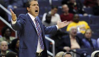 Washington Wizards head coach Randy Wittman gestures during the second half of an NBA basketball game against the Utah Jazz, Saturday, Nov. 17, 2012, in Washington. The Jazz won 83-76. (AP Photo/Nick Wass)