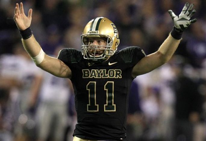 Baylor quarterback Nick Florence (11) celebrates a touchdown during the third quarter for the NCAA college football game against Kansas State, Saturday, Nov. 17, 2012, in Waco Texas. (AP Photo/LM Otero)