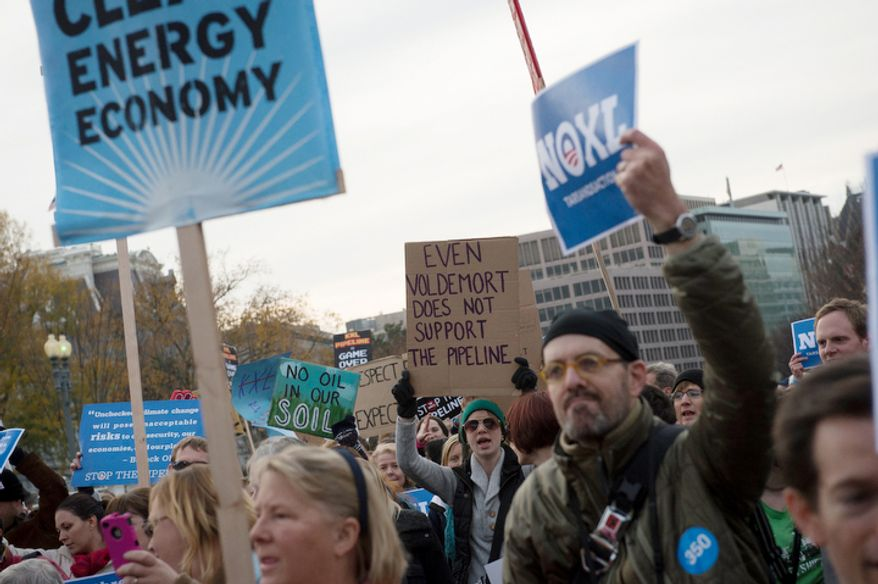 People carry signs and banners as they pass by The White House to protest the Keystone Pipeline, in Washington, D.C., Sunday, Nov. 18, 2012. (Rod Lamkey Jr./The Washington Times)