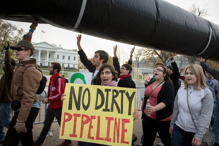 People cary a mock pipeline as they pass by The White House to protest the Keystone Pipeline, in Washington, D.C., Sunday, Nov. 18, 2012. (Rod Lamkey Jr./The Washington Times)