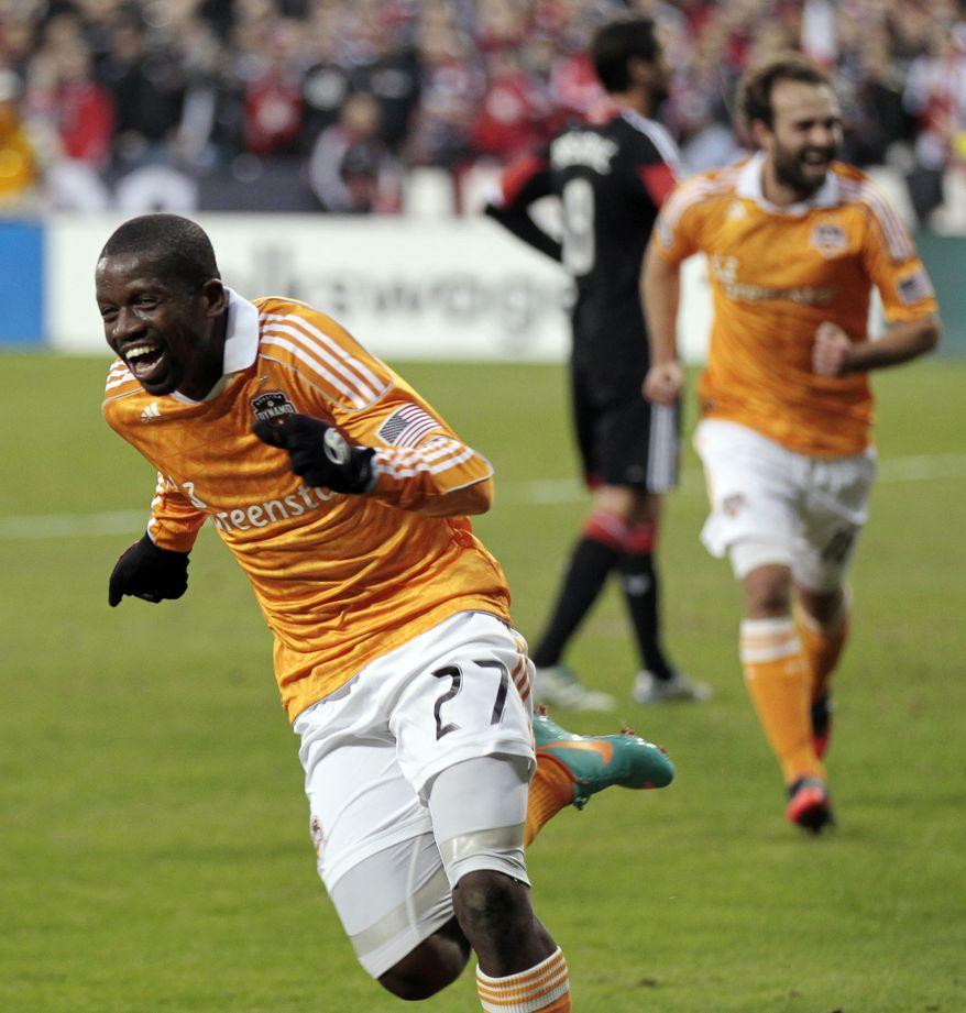 Houston Dynamo's Boniek Garcia (27) celebrates after scoring a goal against DC United during the first half of Game 2 of their MLS soccer Eastern Conference semifinal playoff match, Sunday, Nov. 18, 2012, in Washington. (AP Photo/Luis M. Alvarez)