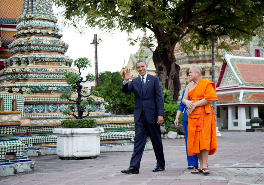 U.S. President Barack Obama, left, and U.S. Secretary of State Hillary Rodham Clinton, rear, tour the Wat Pho Royal Monastery with Chaokun Suthee Thammanuwat, Dean, Faculty of Buddhism Assistant to the Abbot of Wat Phra Chetuphon, in Bangkok, Thailand. Obama asked a blessing for help with the fiscal cliff. (AP Photo/Carolyn Kaster)