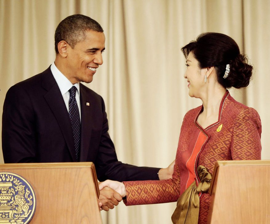 U.S. President Barack Obama, left, and Thai Prime Minister Yingluck Shinawatra shake hands following the conclusion of their joint news conference at Thai Government House in Bangkok, Thailand. (AP Photo/Pablo Martinez Monsivais)
