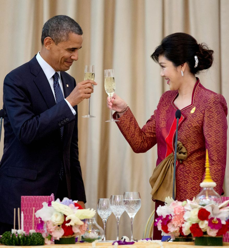 U.S. President Barack Obama, left, and Thai Prime Minister Yingluck Shinawatra toast during an official dinner at Government House in Bangkok, Thailand,. (AP Photo/Carolyn Kaster)