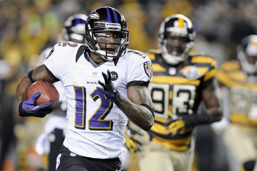 Baltimore Ravens' Jacoby Jones (12) returns a punt past Pittsburgh Steelers Jason Worilds (93) on his way to a touchdown in the first quarter of an NFL football game on Sunday, Nov. 18, 2012, in Pittsburgh. (AP Photo/Don Wright)