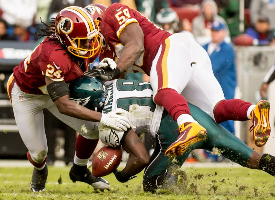 Washington Redskins strong safety DeJon Gomes (24) and Washington Redskins inside linebacker London Fletcher (59) breaks up a pass intended for Philadelphia Eagles wide receiver Jeremy Maclin (18) in the fourth quarter as the Washington Redskins play the Philadelphia Eagles at FedEx Field, Landover, Md., Sunday, Nov. 18, 2012. (Andrew Harnik/The Washington Times)