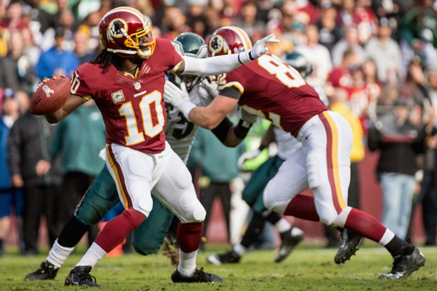 Washington Redskins quarterback Robert Griffin III (10) winds up to complete a 49 yard touchdown pass to Washington Redskins wide receiver Aldrick Robinson (11) in the second quarter as the Washington Redskins play the Philadelphia Eagles at FedEx Field, Landover, Md., Sunday, Nov. 18, 2012. (Andrew Harnik/The Washington Times)
