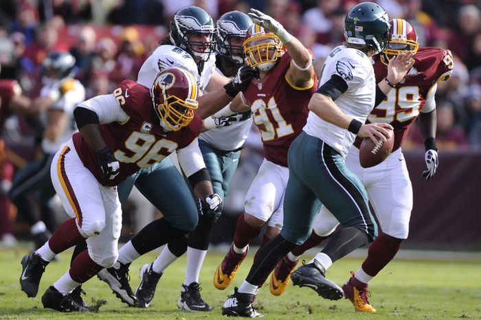 Philadelphia Eagles guard Dennis Kelly (67) is called for holding against Washington Redskins outside linebacker Ryan Kerrigan (91), which killed the momentum of the Eagles' drive during the first quarter at FedEx Field, Landover, Md., Nov. 18, 2012. (Preston Keres/Special to The Washington Times)