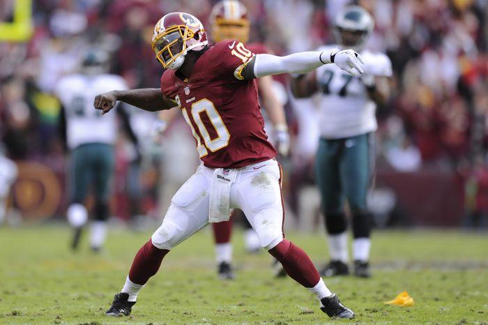 Washington Redskins quarterback Robert Griffin III (10) celebrates his 61-yard touchdown pass to wide receiver Santana Moss in the third quarter at FedEx Field, Landover, Md., Nov. 18, 2012. (Preston Keres/Special to The Washington Times)