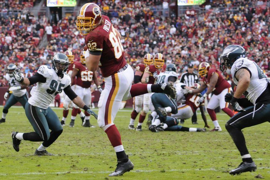 Washington Redskins tight end Logan Paulsen (82) hauls in a 17-yard touchdown pass from quarterback Robert Griffin III (10) at FedEx Field, Landover, Md., Nov. 18, 2012. (Preston Keres/Special to The Washington Times)