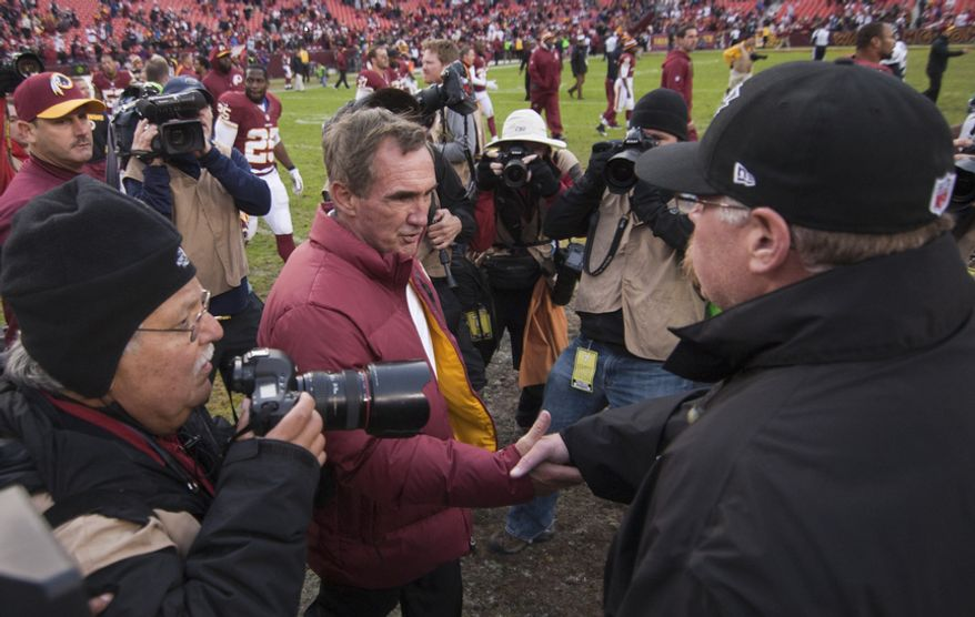 Washington Redskins head coach Mike Shanahan shacks hands with Philadelphia Eagles head coach Andy Reid after winning 31 to 3, Landover, Md., Sunday, November 18, 2012.  (Craig Bisacre/The Washington Times)
