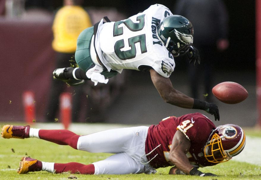 Washington Redskins free safety Madieu Williams (41) hits  Philadelphia Eagles running back LeSean McCoy (25) in the second quarter forcing a fumble, Landover, Md., Sunday, November 18, 2012. (Craig Bisacre/The Washington Times)