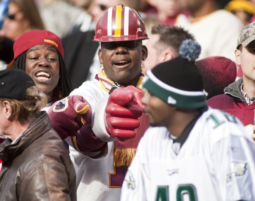 Washington Redskins fans taunt Philadelphia Eagles fans after the Redskins score their second touchdown in the first half, Landover, Md., Sunday, November 18, 2012.  (Craig Bisacre/The Washington Times)