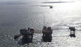 This aerial photograph shows an oil rig damaged from an explosion and fire in the Gulf of Mexico, about 25 miles southeast of Grand Isle, La., Friday, Nov. 16, 2012. Four people were transported to a hospital with critical burns and two were missing. (AP Photo/Gerald Herbert)