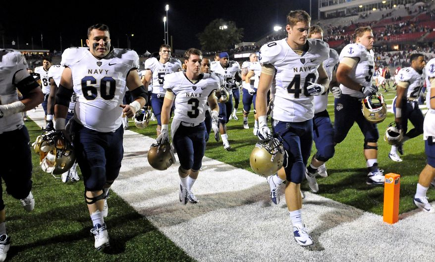 Navy players leave the field after an NCAA college football game against Troy in Troy, Ala., Saturday, Nov. 10, 2012. Troy won 41-31. (AP Photo/The (Troy) Messenger, Thomas Graning) MANDATORY CREDIT