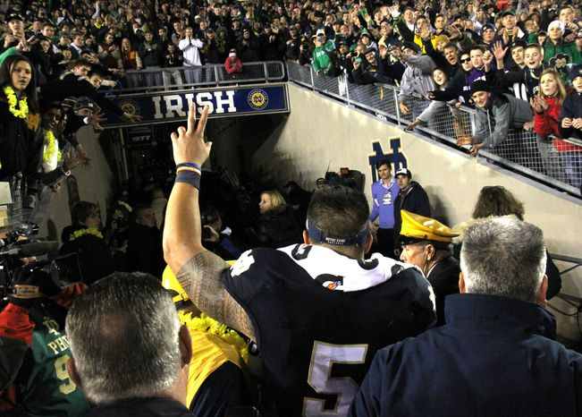 Notre Dame senior lineback Manti Te'o walks into the tunnel at Notre Dame stadium after a 38-0 win over Wake Forest Saturday Nov. 17, 2012 in South Bend, Ind. As a senior, it was Te'o's final home game. (AP Photo/The Goshen News, Sam Householder)