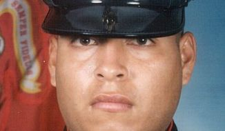 "This undated photo released by the U.S. Marines, shows Sgt. Rafael Peralta, 25. Peralta is being considered for a posthumous Medal of Honor, the United States' highest military award. Peralta was shot during a house-to-house search in Fallujah. Lying wounded on the floor of a home, he grabbed a grenade that had been lobbed in by an insurgent. The blast killed him. ""If he wouldn't have scooped up the grenade, the other three of us in the room that day would have been killed,"" said former Cpl. Robert Reynolds, who was in Peralta's squad. (AP Photo/U.S. Marines)"