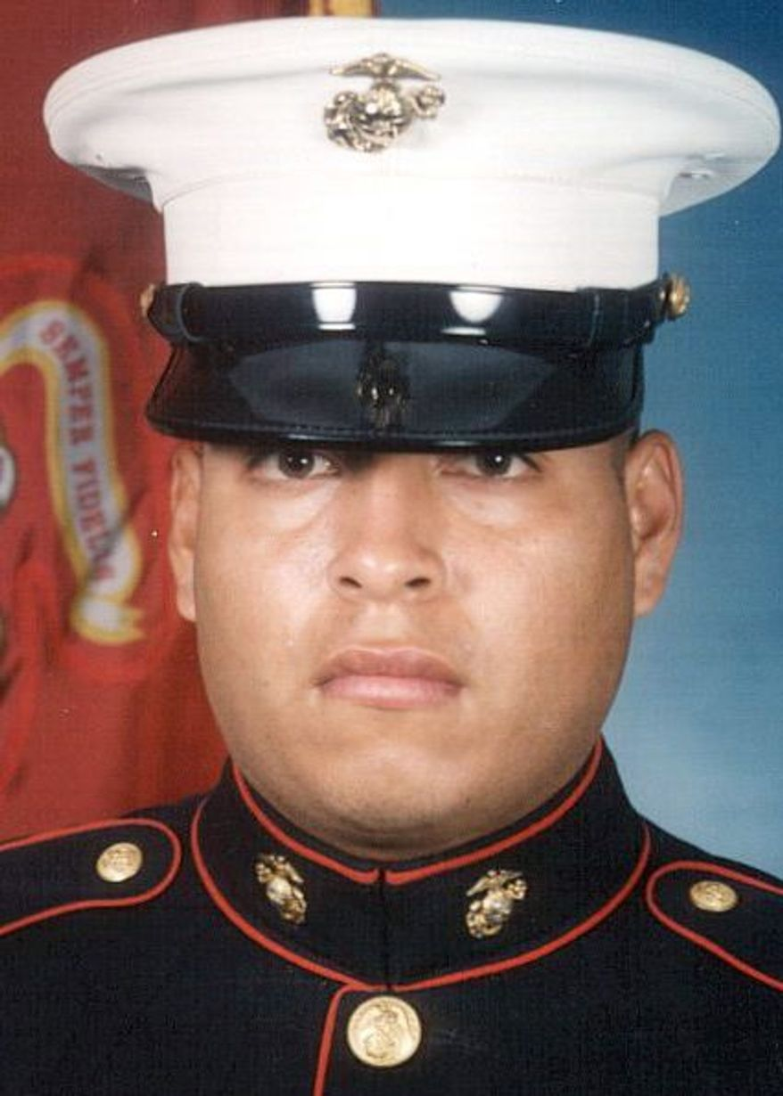 """This undated photo released by the U.S. Marines, shows Sgt. Rafael Peralta, 25. Peralta is being considered for a posthumous Medal of Honor, the United States' highest military award. Peralta was shot during a house-to-house search in Fallujah. Lying wounded on the floor of a home, he grabbed a grenade that had been lobbed in by an insurgent. The blast killed him. """"If he wouldn't have scooped up the grenade, the other three of us in the room that day would have been killed,"""" said former Cpl. Robert Reynolds, who was in Peralta's squad. (AP Photo/U.S. Marines)"""