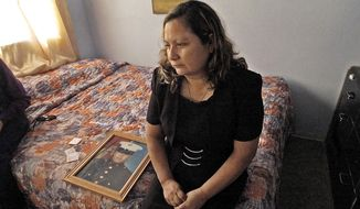 Rosa Maria Peralta visits her son's bedroom at her home in San Diego shortly after his death. Sgt. Rafael Peralta was killed in action in Fallujah, Iraq, in 2004. (San Diego Union-Tribune)