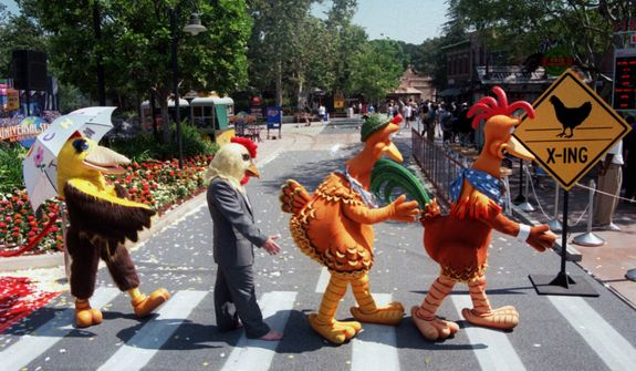 """Characters from the recently-opened Universal Studios' release """"Chicken Run"""" mimic a scene in a photo of the Beatles used as the cover for the band's """"Abbey Road"""" album, during the opening ceremonies for a new attraction called """"Chicken Run Maze,"""" which is based on the movie, at Universal Studios Hollywood in Universal City, Calif., Tuesday, June 20, 2000. (AP Photo/Universal Studios Hollywood, Michael Tweed)"""