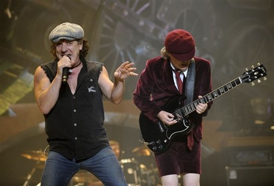 "** FILE ** In this Nov. 12, 2008, file photo, AC/DC lead singer Brian Johnson, left, and Angus Young perform on the Black Ice tour at Madison Square Garden in New York. Columbia Records and Apple announced Monday, Nov. 19, 2012, that the classic rock band's music will be available at the iTunes Store worldwide. Sixteen albums will be released, including ""High Voltage"" and ""Back in Black."" (AP Photo/Jeff Zelevansky, file)"