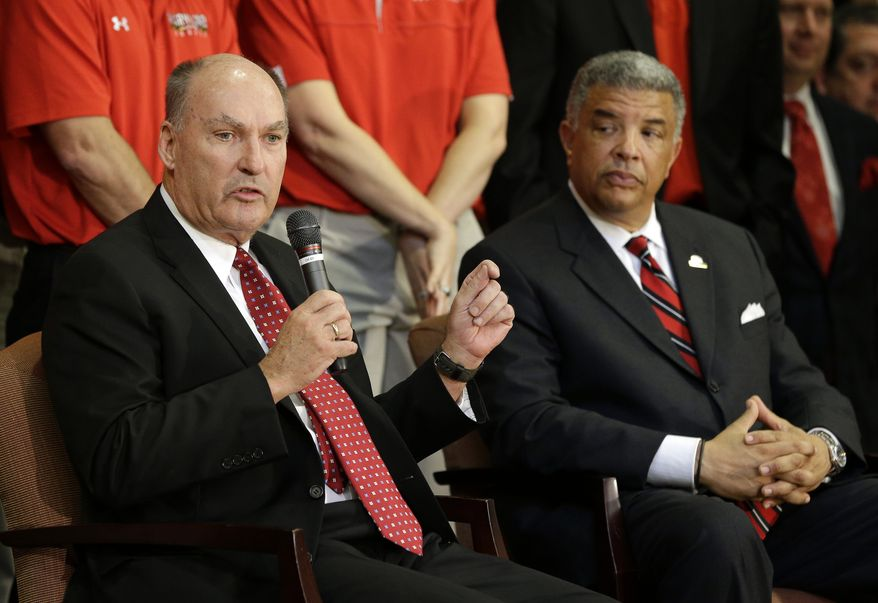 Big Ten Commissioner James Delany, left, speaks at a news conference to announce the University of Maryland's decision to move to the Big Ten in College Park, Md., Monday, Nov. 19, 2012. Seated alongside Delany is Maryland athletic director Kevin Anderson. Maryland is joining the Big Ten, leaving the Atlantic Coast Conference in a shocker of a move in the world of conference realignment that was driven by the school's budget woes. (AP Photo/Patrick Semansky)