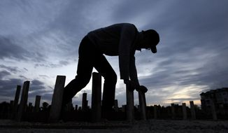 **FILE** Ford Smith works on a new home under construction in Chicago on Oct. 11, 2012. (Associated Press)