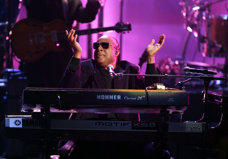 """Stevie Wonder and the Rickey Minor Band perform """"Master Blaster,"""" """"My Cherie Amour"""" and """"Sir Duke"""" during a tribute to Dick Clark at the 40th Anniversary American Music Awards in Los Angeles on Nov. 18, 2012. (John Shearer/Invision/Associated Press)"""