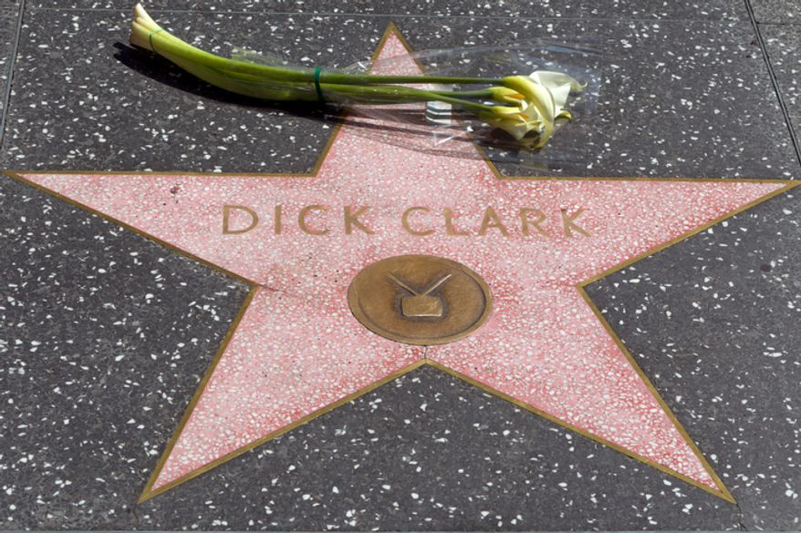 "**FILE** Flowers are left at the star honoring television host Dick Clark on the Walk of Fame in Los Angeles on April 18, 2012. Clark, the television host and entrepreneur who helped bring rock 'n' roll into the mainstream on ""American Bandstand,"" and later produced and hosted a vast range of programming from game shows to the New Year's Eve countdown from Times Square, died of a heart attack on April 18, 2012. He was 82. (Associated Press)"