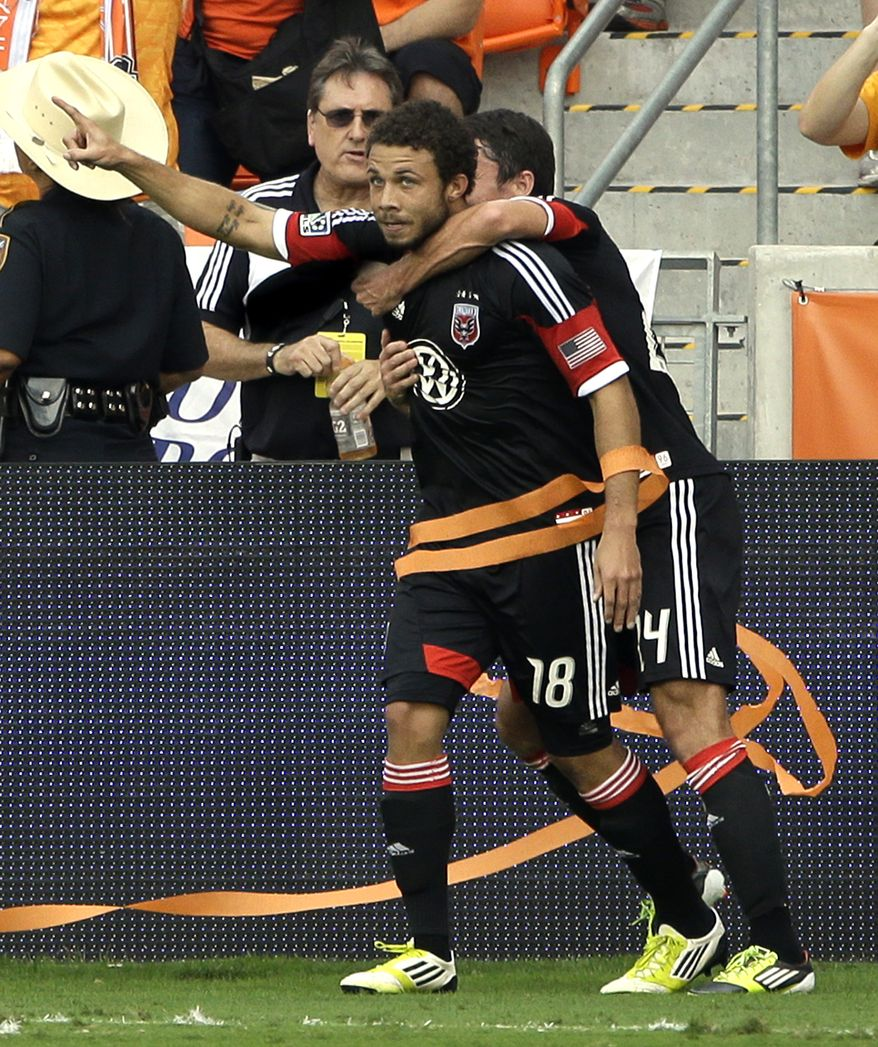 D.C. United's Nick DeLeon (18) celebrates his goal with Lewis Neal, right, during the first half of an MLS Eastern Conference Championship soccer game against the Houston Dynamo, Sunday, Nov. 11, 2012, in Houston. (AP Photo/David J. Phillip)