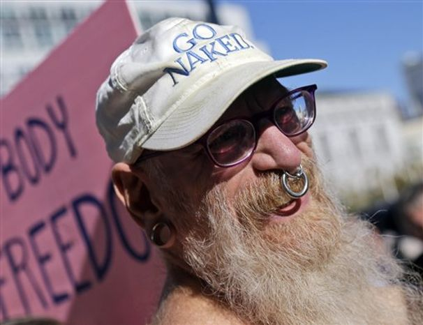 Woody Miller attends a rally in opposition to a city-wide nudity ban outside of City Hall in San Francisco, Wednesday, Nov. 14, 2012. San Francisco appears poised to shed part of its image as a city where anything goes, including clothing. (AP Photo/Marcio Jose Sanchez)