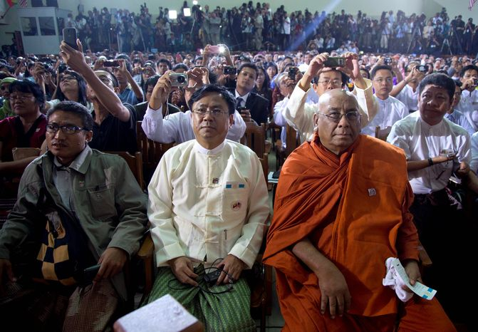 Members of the audience, including Myanmar Buddhist leader Sitagu Sayadaw (right front), look to the stage Nov. 19, 2012, as President Obama speaks at Yangon University in Yangon, Myanmar. It was the first visit to Myanmar by a sitting U.S. president. (Associated Press)