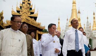 President Obama (right) tours the Shwedagon Pagoda in Yangon, Myanmar, on Nov. 19, 2012. In a historic trip to a long shunned land, Obama showered praise and promises of more U.S. help to Myanmar if the Asian nation keeps building its new democracy. (Associated Press)