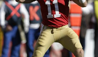 San Francisco 49ers quarterback Alex Smith against the St. Louis Rams during the first quarter of an NFL football game in San Francisco, Sunday, Nov. 11, 2012. (AP Photo/Marcio Jose Sanchez)