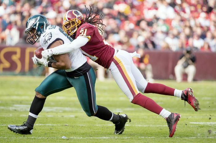 Philadelphia Eagles tight end Clay Harbor (82) is tacked by Washington Redskins defensive back Brandon Meriweather (31) in the second quarter as the Washington Redskins play the Philadelphia Eagles at FedEx Field, Landover, Md., Sunday, Nov. 18, 2012. (Andrew Harnik/The Washington Times)