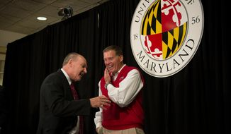 University of Maryland football head coach Randy Edsall (right) chats with Big Ten Commissioner James E. Delany (left) following a press conference to announce the University of Maryland's joining the Big Ten Conference, at the University of Maryland in College Park, Md., Monday, Nov. 19, 2012. (Rod Lamkey Jr./The Washington Times)