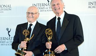 Television legends Norman Lear (left) and Alan Alda claimed the 40th Anniversary Special Founders Award on Monday at the International Emmy Awards. (Associated Press)