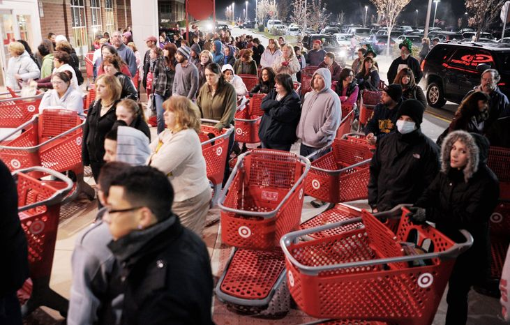 ** FILE ** Crowds of shoppers were ready to storm stores across the country last year as Black Friday began at the stroke of midnight. (Associated Press)