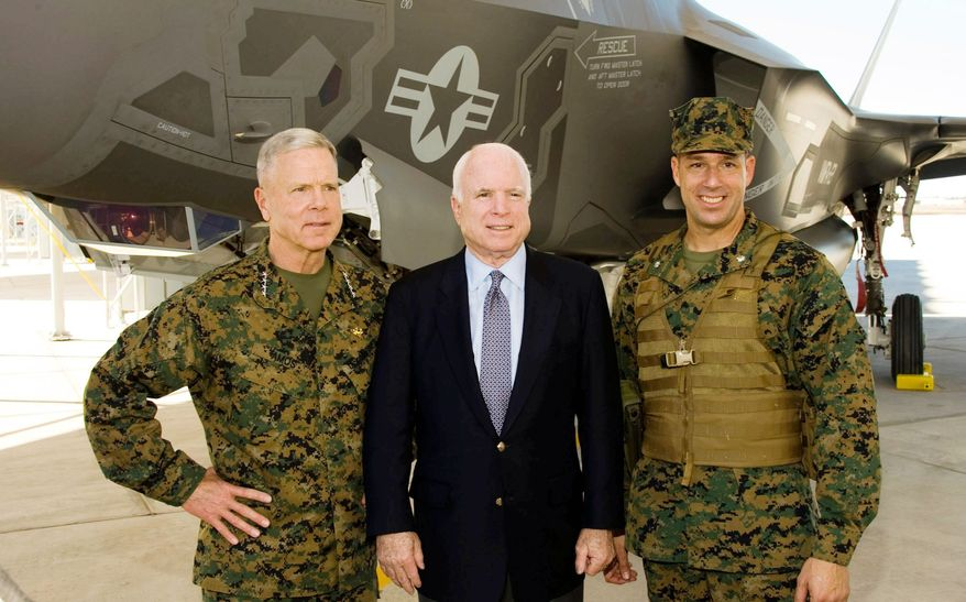 Sen. John McCain, Arizona Republican, is flanked by From the left, Commandant of the Marine Corps Gen. James F. Amos (left) and Lt. Col. Jeffrey Scott to inaugurate Marine Fighter Attack Squadron 121 on Tuesday in Yuma, Ariz. (Lockheed Martin Aeronautics Co.)