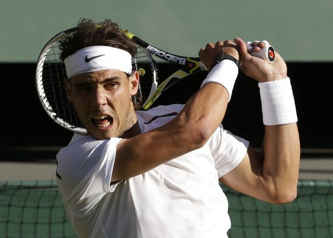 Rafael Nadal of Spain plays a return to Lukas Rosol of the Czech Republic during a second round men's singles match at the All England Lawn Tennis Championships at Wimbledon, England, Thursday, June 28, 2012. (AP Photo/Anja Niedringhaus)