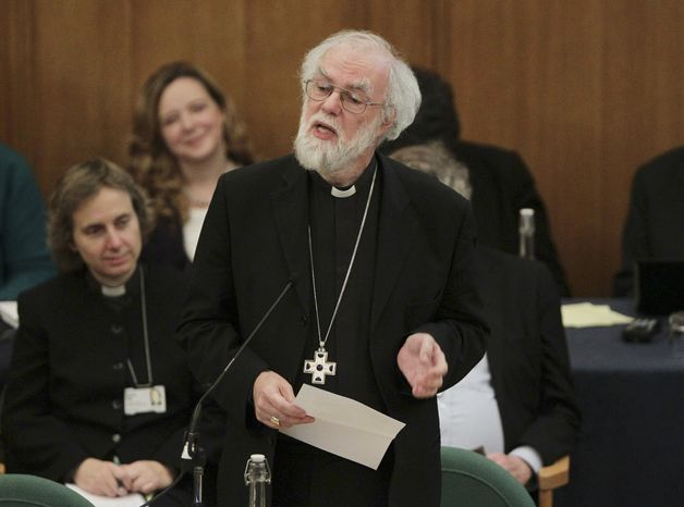 Dr. Rowan Williams (center), the outgoing Archbishop of Canterbury, speaks Nov. 20, 2012, during a meeting of the General Synod of the Church of England in London, where a vote on whether to give final approval to legislation introducing the first women bishops will take place. (Associated Press)