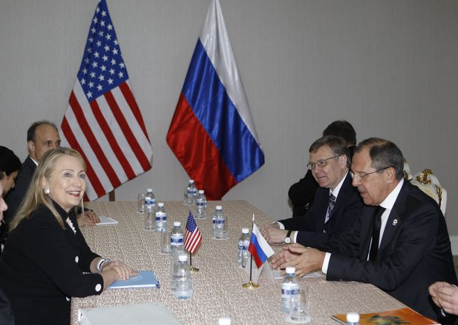 U.S. Secretary of State Hillary Rodham Clinton (left) holds a bilateral meeting with Russian Foreign Minister Sergey Lavrov during the East Asia Summit in Phnom Penh, Cambodia, on Nov. 20, 2012. (Associated Press)