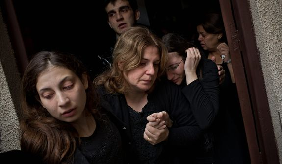 Palestinians mourners cry during the funeral of Salem Paul Sweliem in Gaza City on Nov. 20, 2012. According to the family, the 52-year-old Greek Orthodox Christian carpenter was killed during an Israel Air Force strike on a high-rise building, in which Ramez Harb, a senior figure in Islamic Jihad's military wing, was killed. Sweliem was in car when the strike took place and died on his way to the hospital from shrapnel wounds. (Associated Press)
