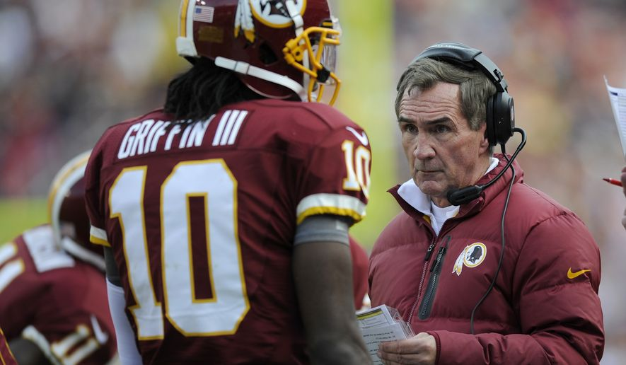 Redskins quarterback Robert Griffin III and coach Mike Shanahan won't have as much time to strategize before Thursday's game against Dallas. Washington needs a win to stay in the NFC East hunt. (AP Photo/Nick Wass)