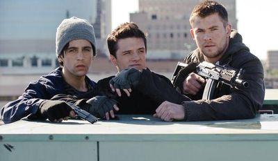 "Josh Peck (left), Josh Hutcherson (center) and Chris Hemsworth star in ""Red Dawn."" (Associated Press/Film District)"